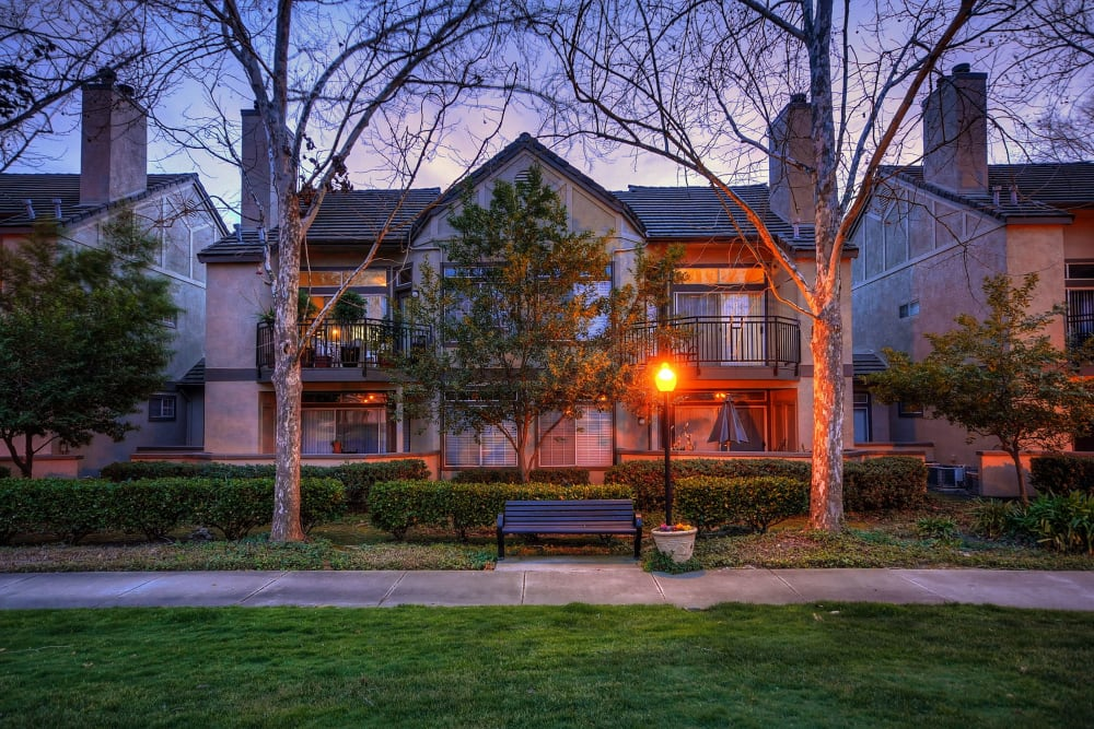 The view of the clubhouse at dusk at Larkspur Woods in Sacramento, California
