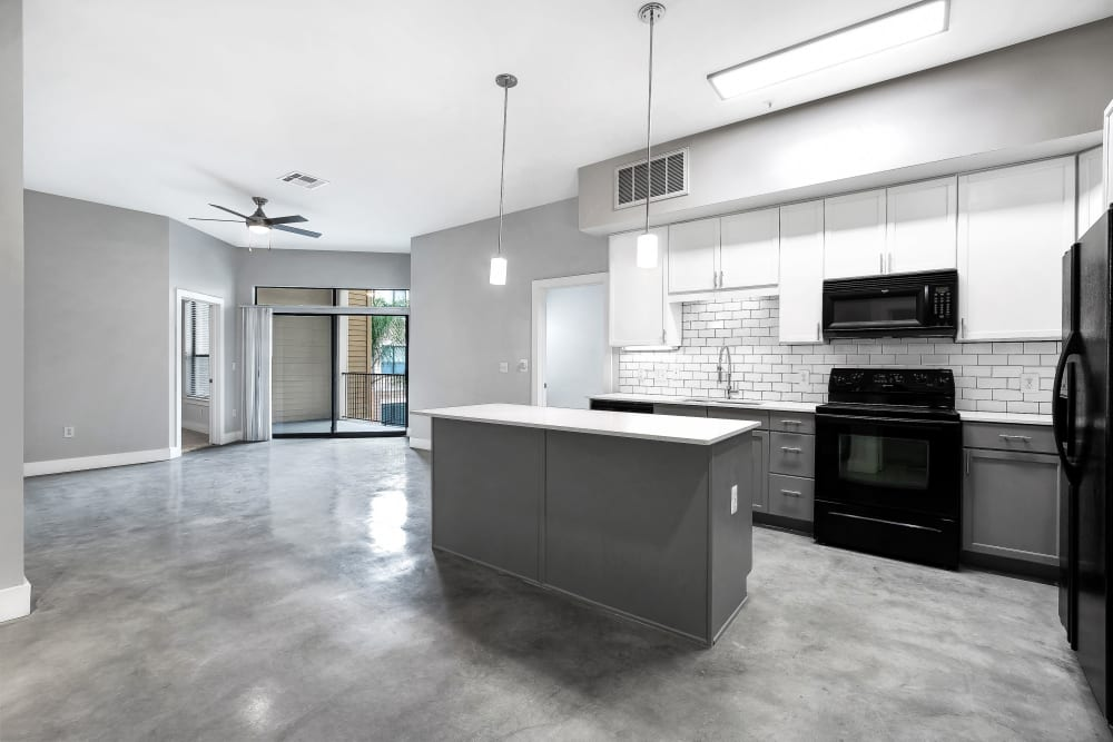 Spacious kitchen and living room at Residences at The Triangle in Austin, Texas
