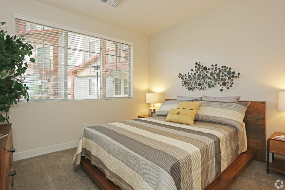 Resident bedroom with large windows at Mountain Trail in Flagstaff, Arizona