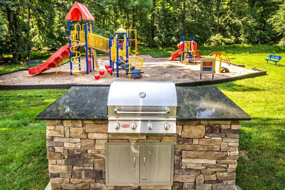 Gas barbecue grills near the onsite children's playground at Park at Winterset Apartments in Owings Mills, Maryland