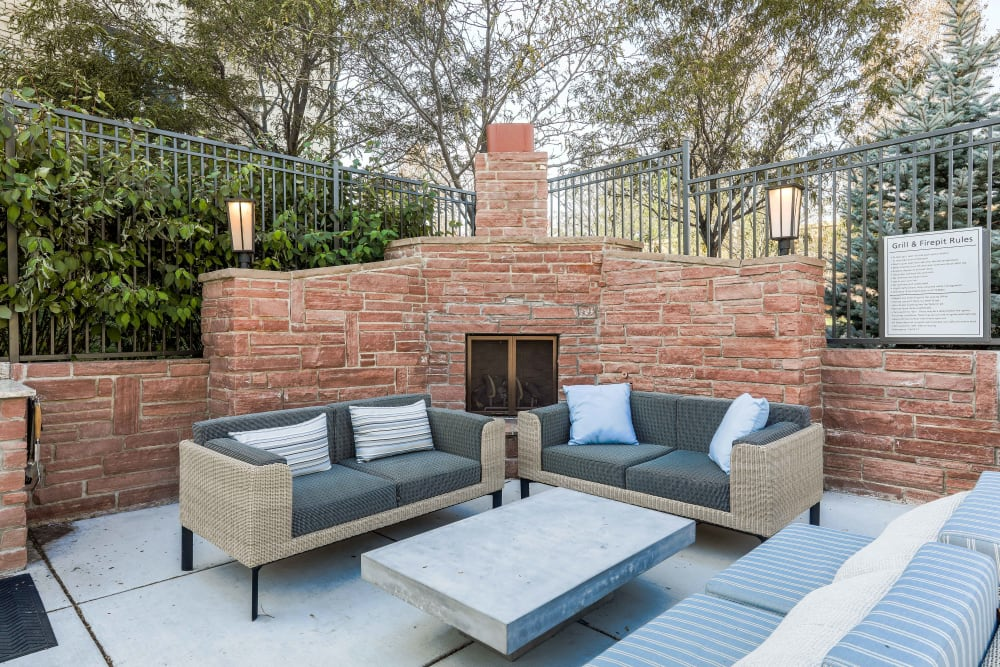 Outdoor poolside couches at Summit at Flatirons Apartments in Broomfield, Colorado