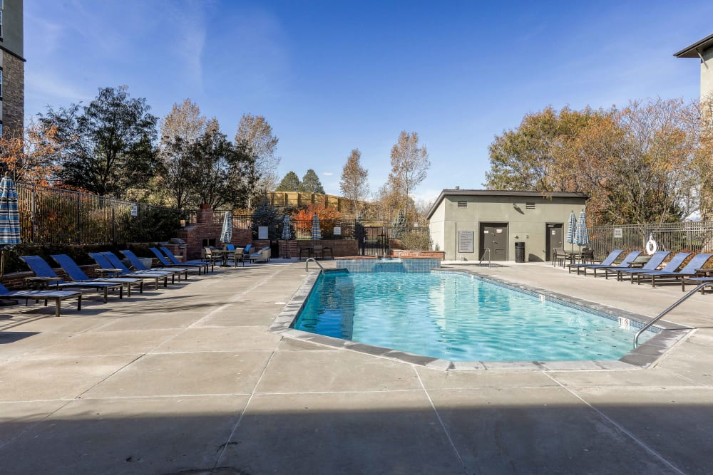 Resort-style outdoor swimming pool at Summit at Flatirons Apartments in Broomfield, Colorado
