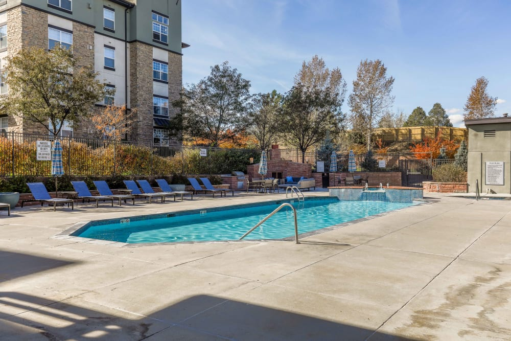 Sparkling swimming pool at Summit at Flatirons Apartments in Broomfield, Colorado