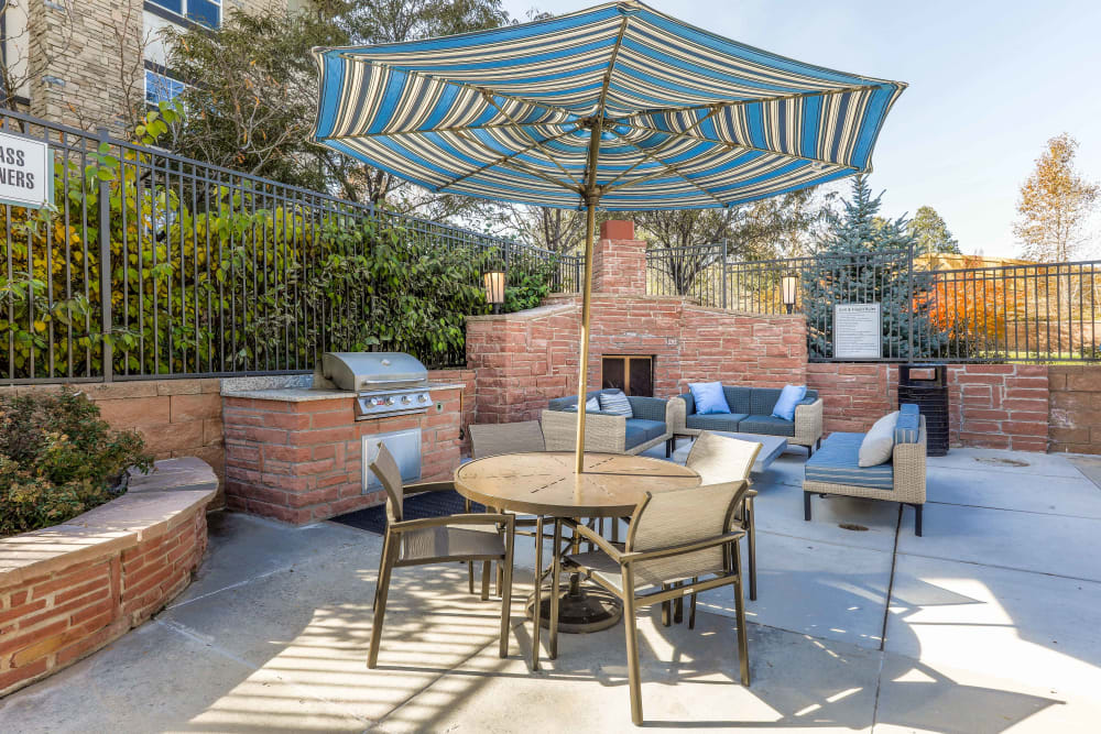 Outdoor patio area at Summit at Flatirons Apartments in Broomfield, Colorado