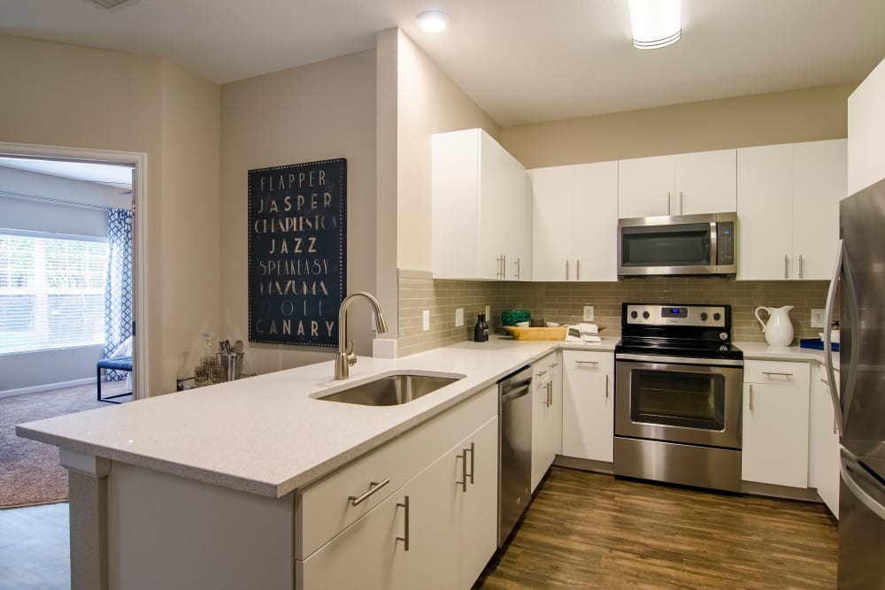 Kitchen with stainless steel appliances at Summit at Flatirons Apartments in Broomfield, Colorado