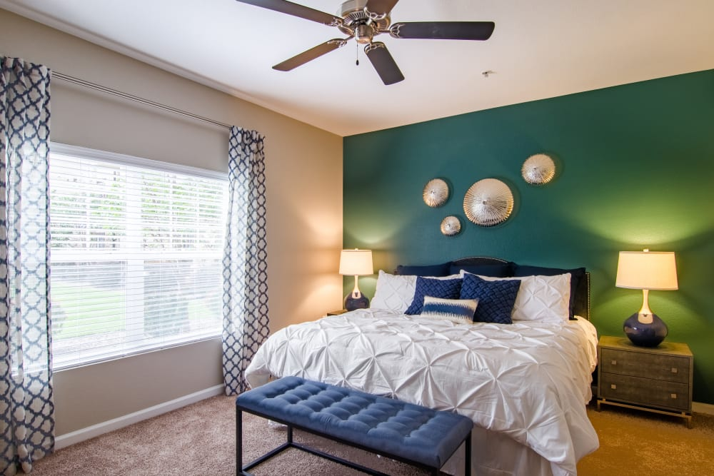 Spacious, bright bedroom at Summit at Flatirons Apartments in Broomfield, Colorado