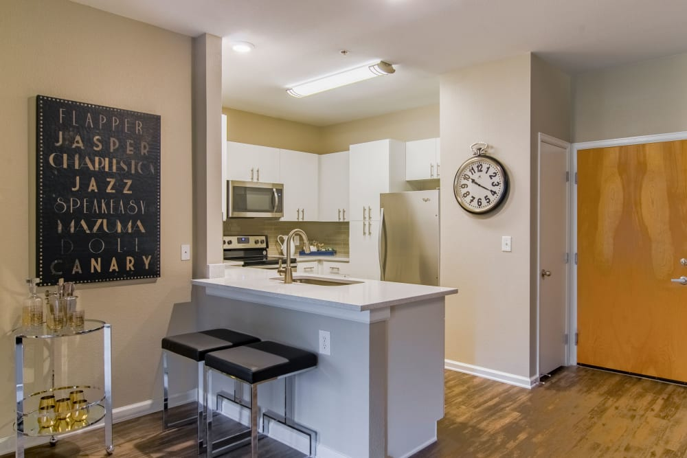 Sleek, modern kitchen at Summit at Flatirons Apartments in Broomfield, Colorado
