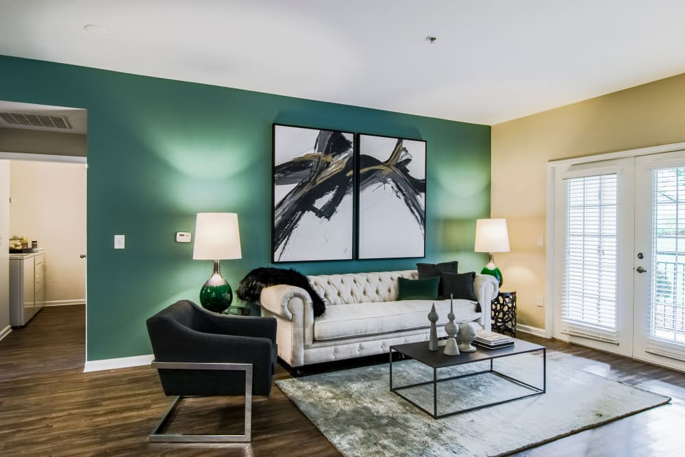 Well decorated living room at Summit at Flatirons Apartments in Broomfield, Colorado