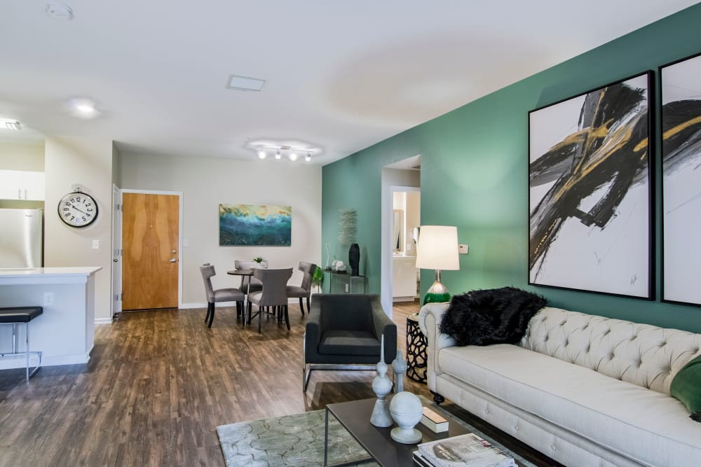 Bright, well-decorated living room at Summit at Flatirons Apartments in Broomfield, Colorado