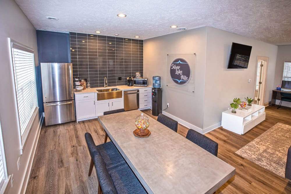 A clubhouse kitchen with stainless-steel appliances at Silver Lake Hills in Fenton, Michigan