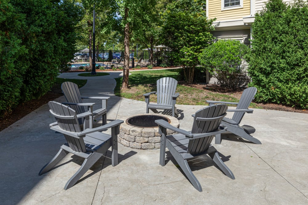 Outdoor firepit with seats for guests at Sofi at Salem Station in Salem, Massachusetts