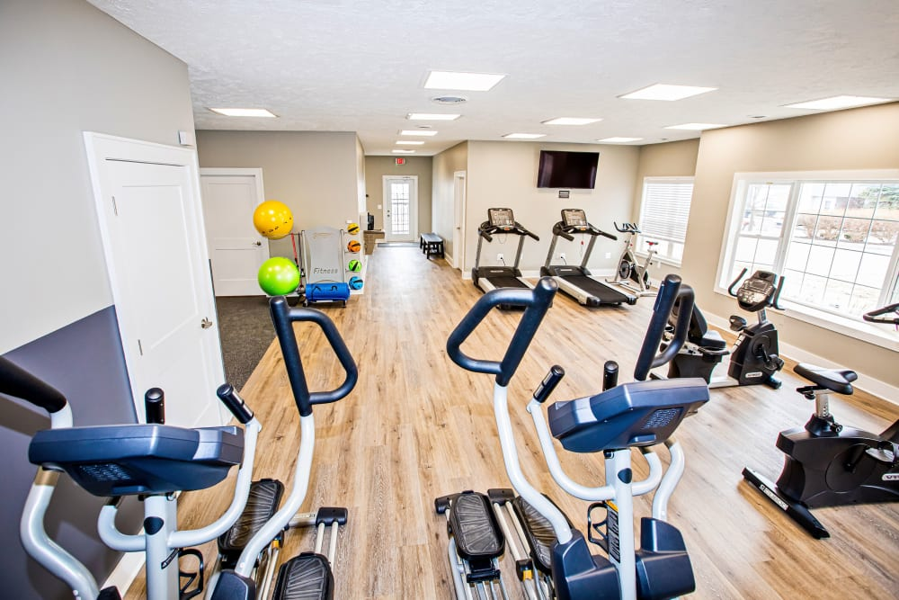 A fitness center with a weight station at Silver Lake Hills in Fenton, Michigan