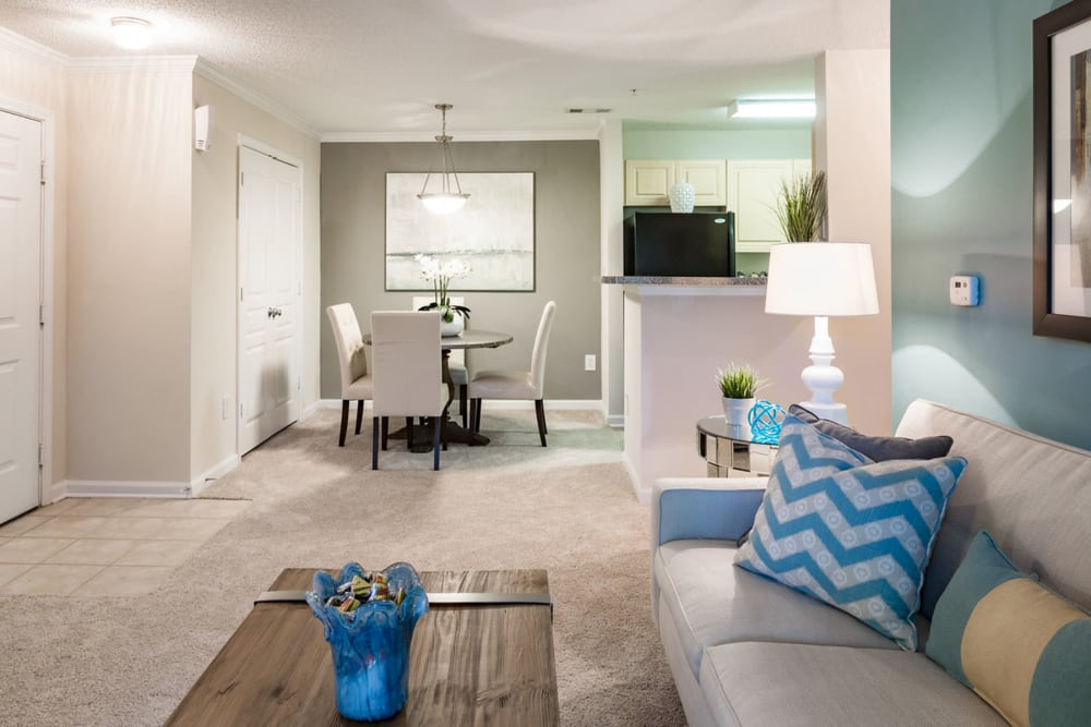 Spacious and well-furnished open-concept living area in a model home at The Vinings at Newnan Lakes in Newnan, Georgia