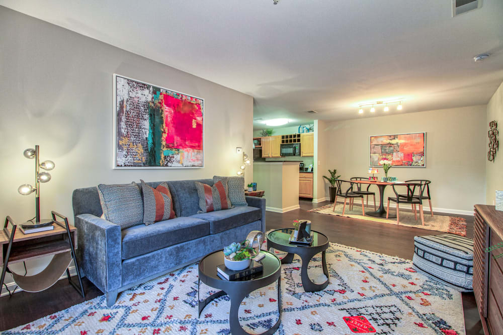Model living room with view of dining area at The Reserve at Ballenger Creek Apartments in Frederick , Maryland
