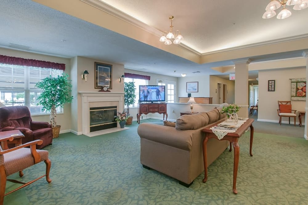 Resident living area with couches at Randall Residence of Newark in Newark, Ohio
