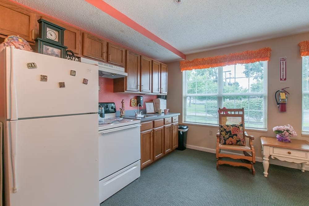 Resident kitchen with fridge and stove at Randall Residence of Newark in Newark, Ohio