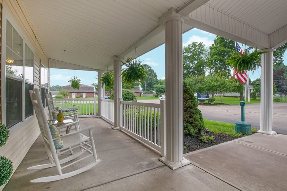 Randall Residence of Newark in Newark, Ohio has a wrap around porch with rocking chairs