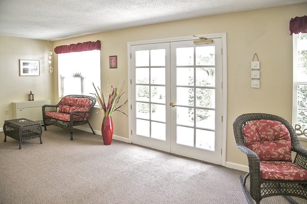 Sitting area with large windows and chairs at Randall Residence of Wheelersburg in Wheelersburg, Ohio
