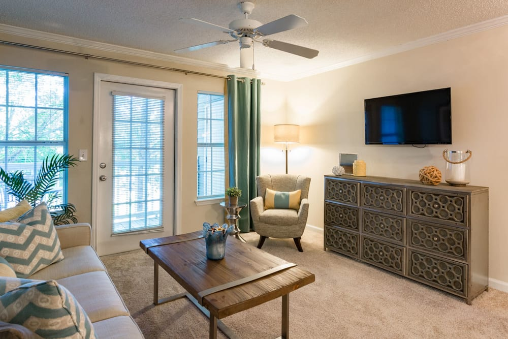Ceiling fan and plush carpeting in a model home's living area at The Vinings at Newnan Lakes in Newnan, Georgia