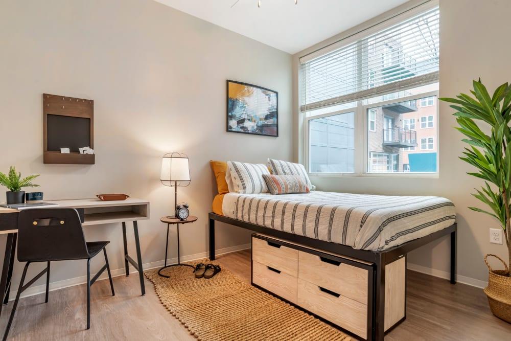 Cozy bedroom at UNCOMMON Auburn in Auburn, Alabama