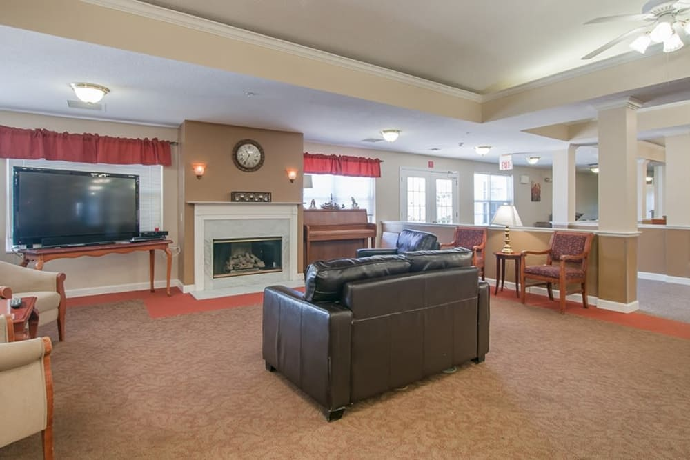 Community room at at Randall Residence of Troy in Troy, Ohio with fireplace