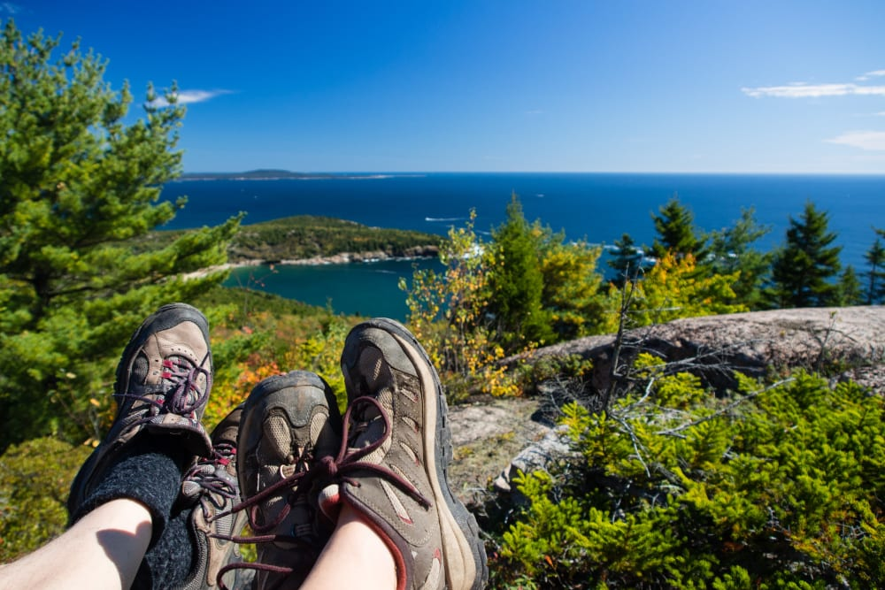 Couple enjoying the views after a hike near The Beacon at Gateway in Scarborough, Maine