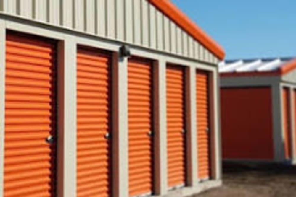 Orange doors of outdoor storage units at Apple Self Storage in Thunder Bay, Ontario