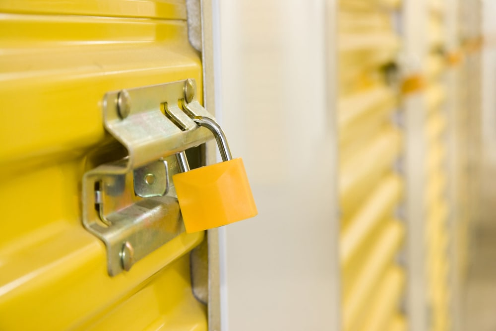 A locked yellow storage unit at Firehouse Self Storage in Loveland, Colorado