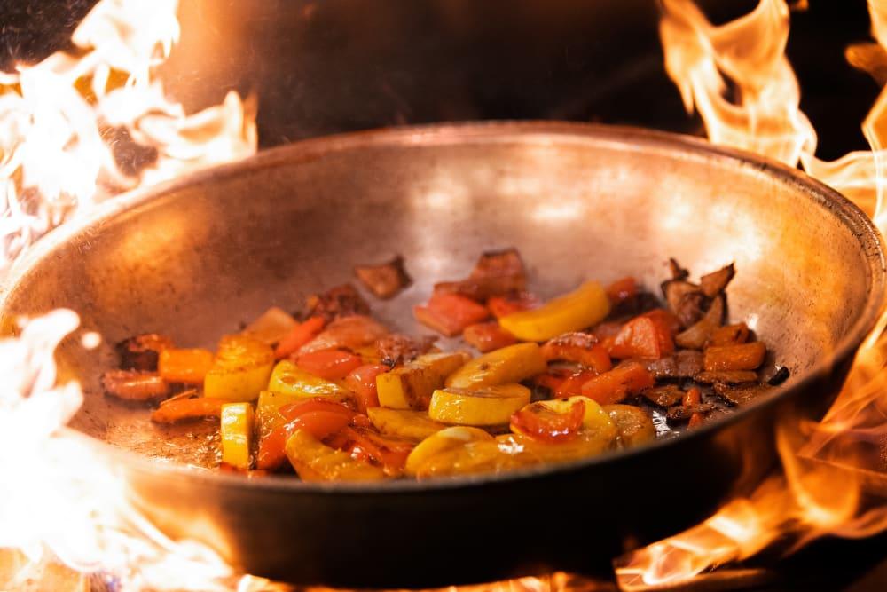 Stir fry in wok at Elk Meadows Assisted Living and Memory Care in Oakley, Utah