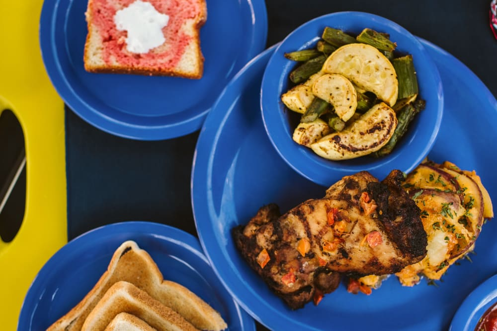Appetizers of chicken and side dishes at at Elk Meadows Assisted Living and Memory Care in Oakley, Utah
