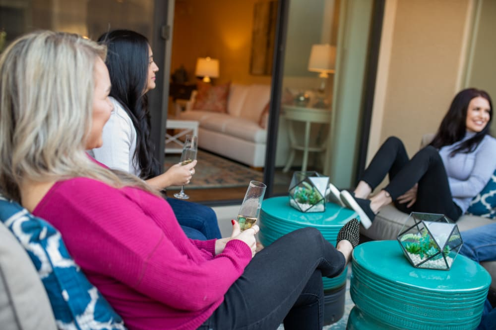 Residents relaxing and enjoying a drink on their patio at ArLo in Phoenix, Arizona