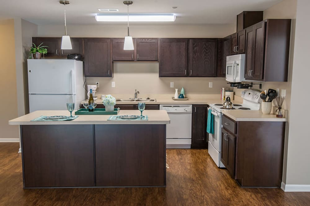 A kitchen with plenty of cabinetry at Silver Lake Hills in Fenton, Michigan
