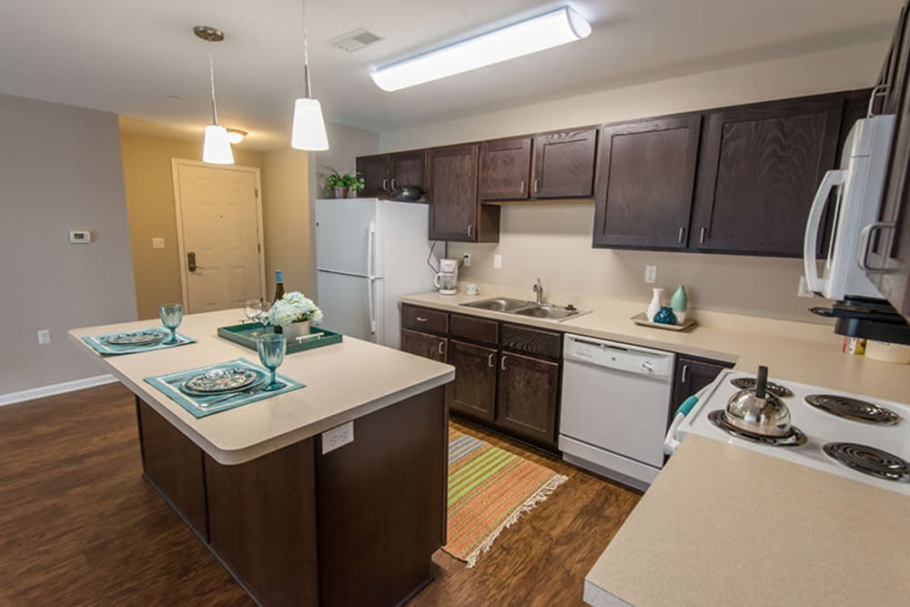 A kitchen with an island at Silver Lake Hills in Fenton, Michigan