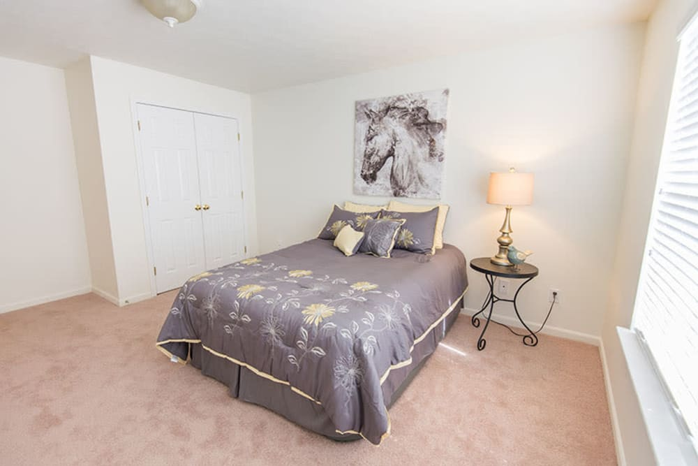 A spacious master bedroom at Silver Lake Hills in Fenton, Michigan