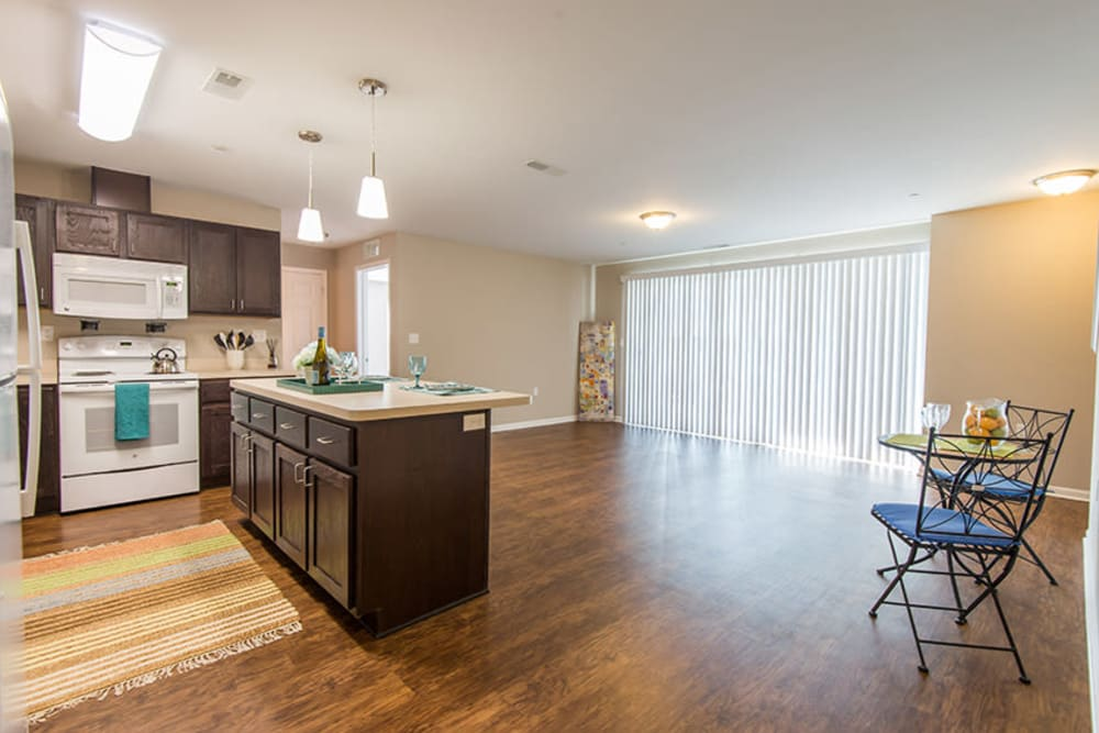 A spacious living room with balcony access at Silver Lake Hills in Fenton, Michigan