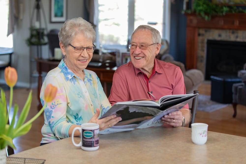 Couple reading together at Touchmark at Wedgewood in Edmonton, Alberta