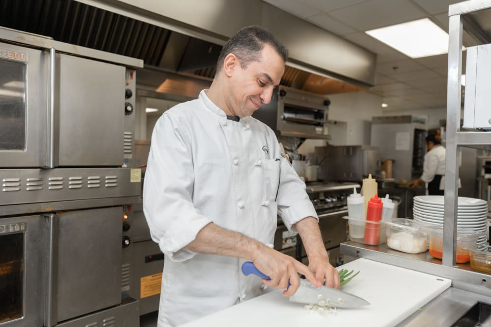 Chef prepping in kitchen at Touchmark at Wedgewood in Edmonton, Alberta