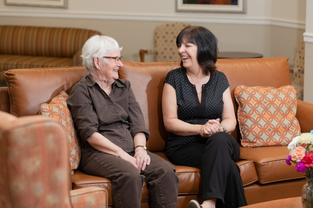Two women on couch at Touchmark at Wedgewood in Edmonton, Alberta
