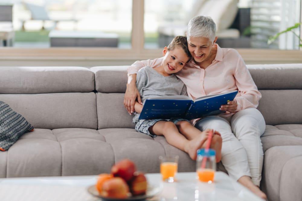Resident reading to her grandson at Roseville Commons Senior Living in Roseville, California
