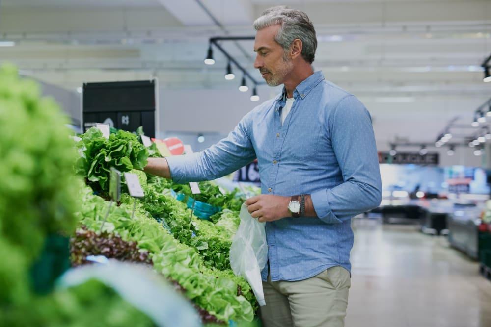 Resident shopping for produce at Winding Commons Senior Living in Carmichael, California