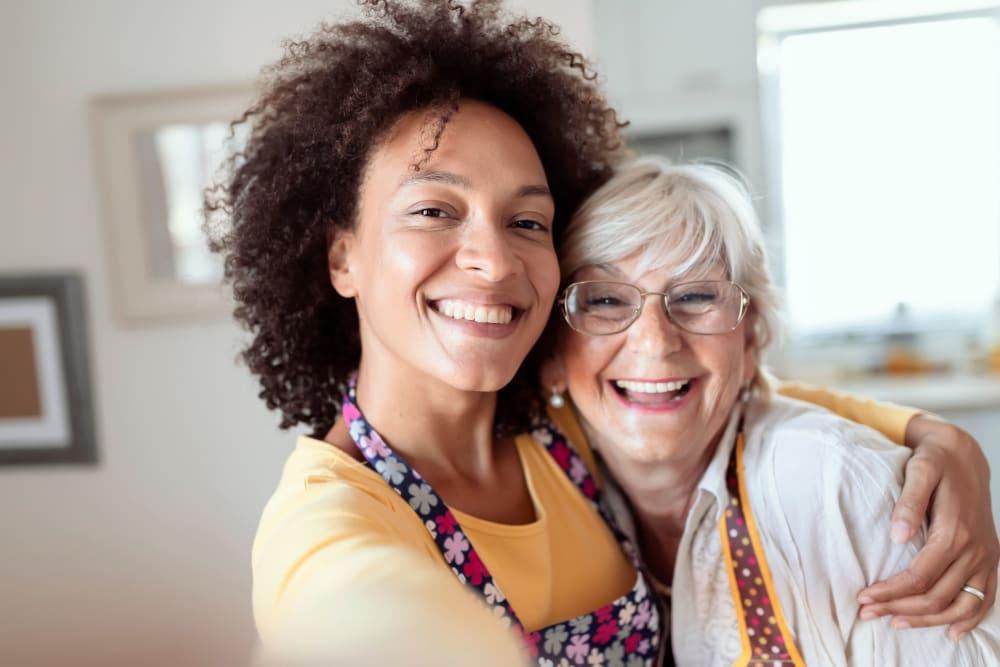 Careworker hugging a resident at Winding Commons Senior Living in Carmichael, California