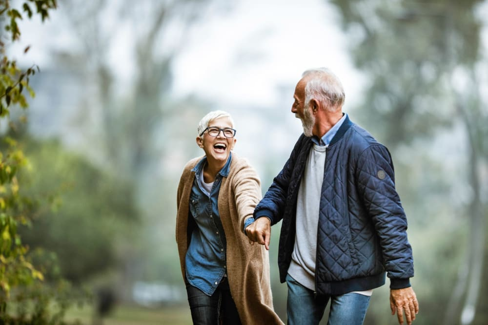 Couple on a walking in Carmichael, California near Winding Commons Senior Living
