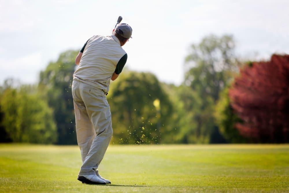 Resident playing golf near Leisure Manor Senior Living in Sacramento, California