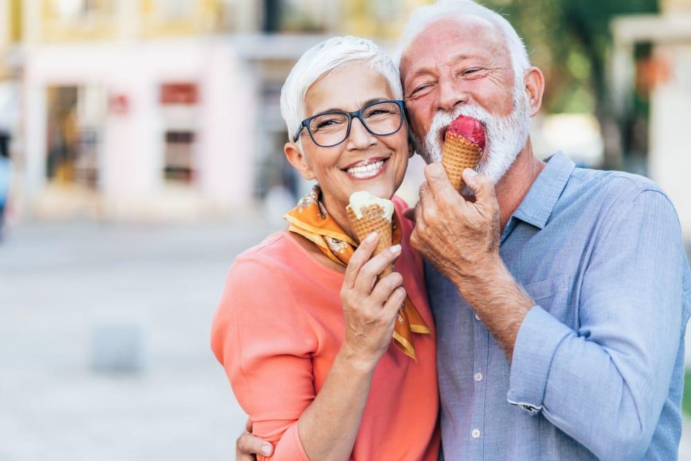 Happy couple eating ice cream together near Castle Vista Senior Duplex Community in Atwater, California