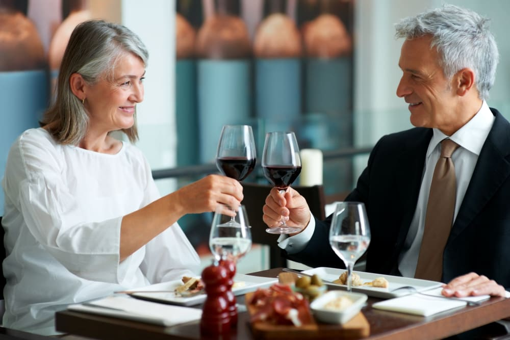 Residents enjoying wine at a local restaurant in Sacramento, California near Leisure Manor Senior Living