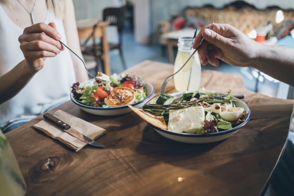 Residents enjoying a salad at Hilltop Commons Senior Living in Grass Valley, California