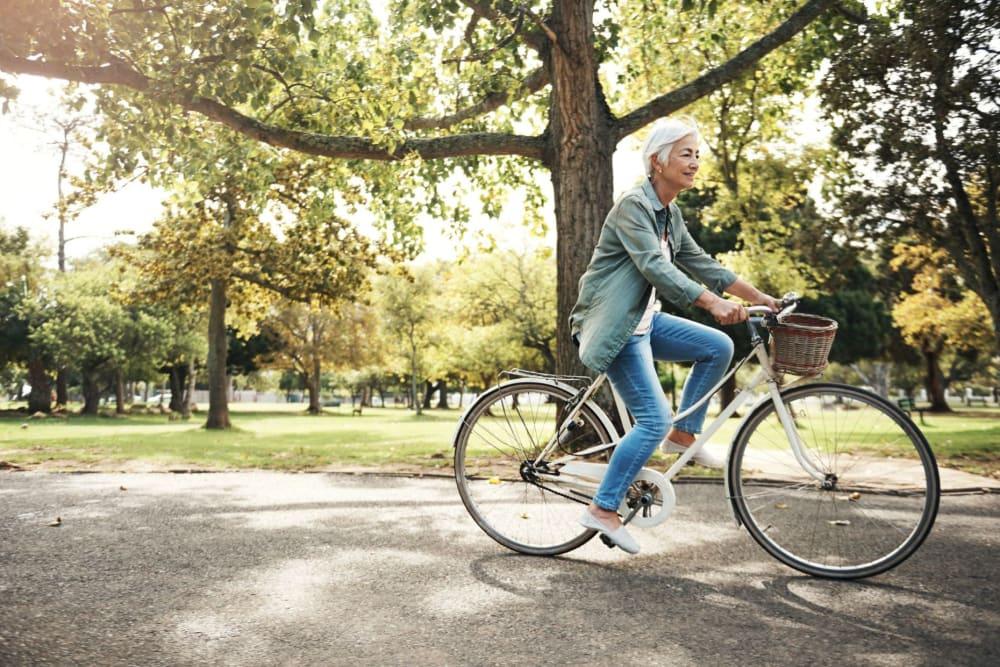 Resident riding their bike near Hilltop Commons Senior Living in Grass Valley, California