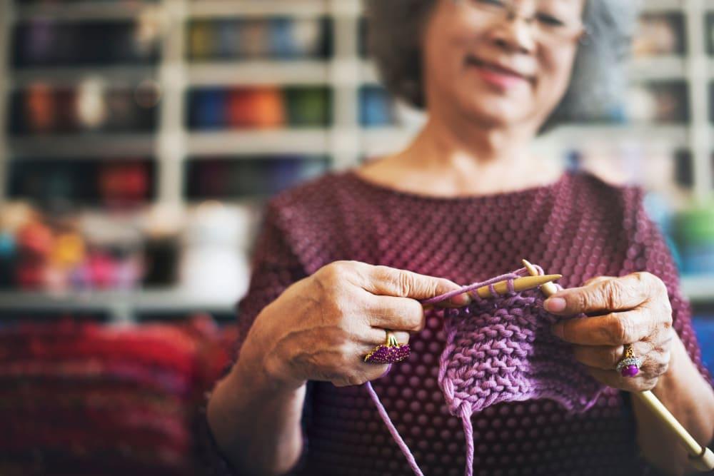 Resident knitting at Hilltop Commons Senior Living in Grass Valley, California