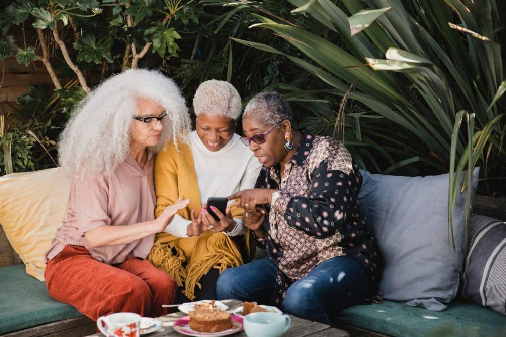 Friends chatting over brunch at River Commons Senior Living in Redding, California