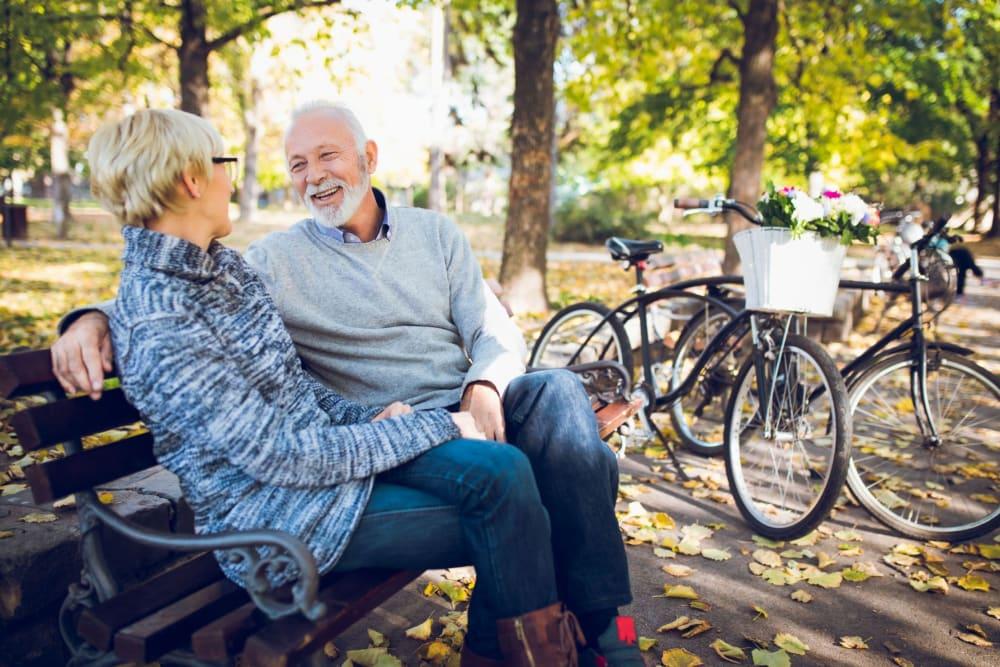 Residents sitting on a bench near River Commons Senior Living in Redding, California